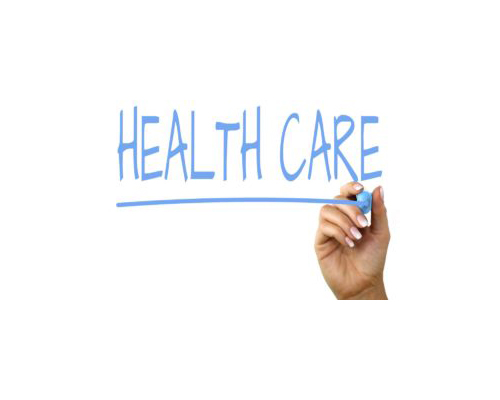 Health care written with a blue whiteboard marker
