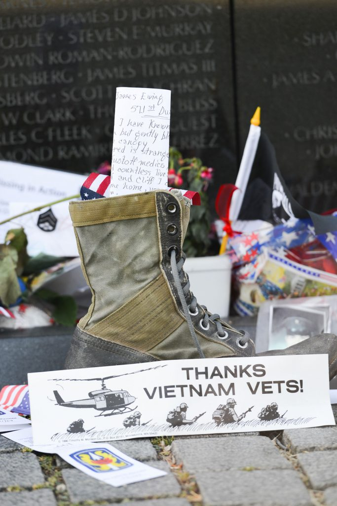 A sign thanking veterans at the Vietnam Veterans Memorial in Washington, D. C